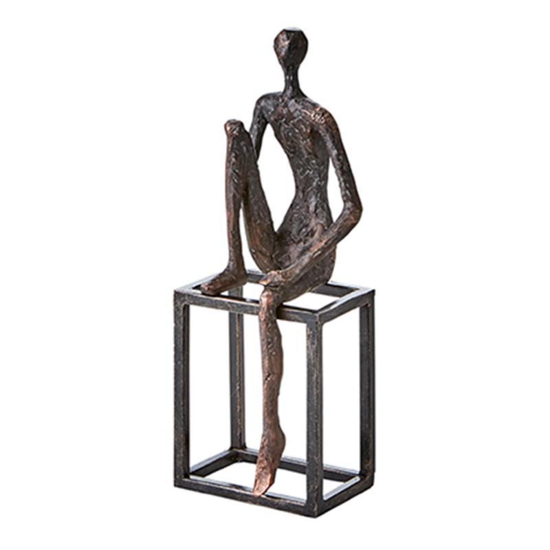 Pose- sitting man