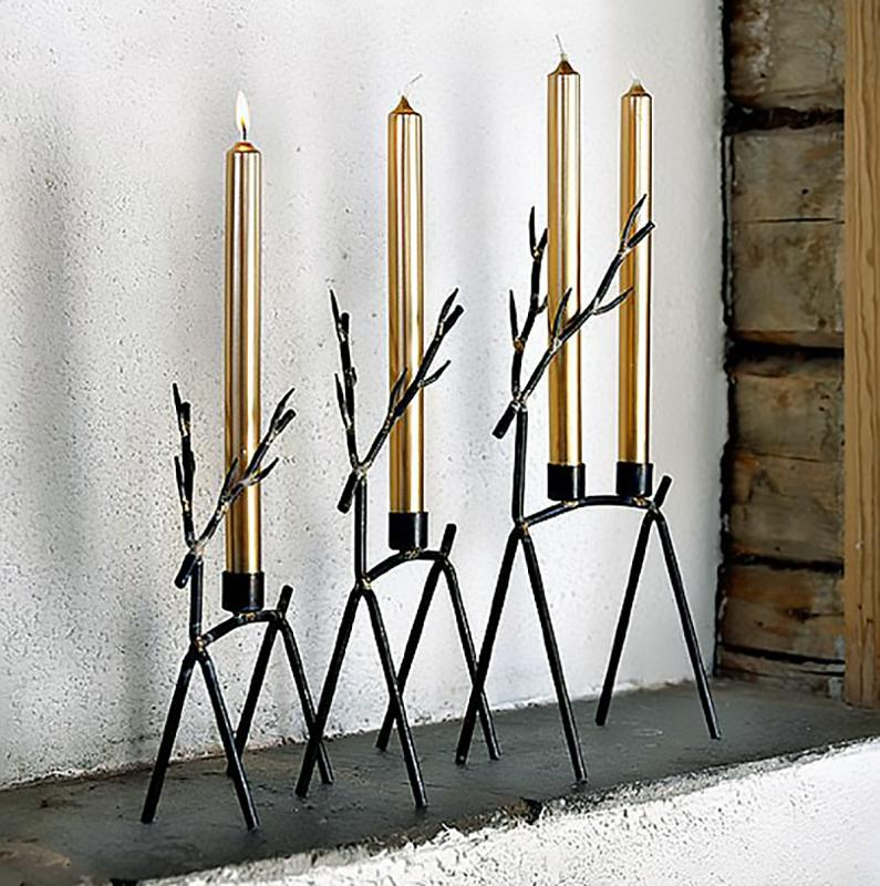 Förslag på billiga presenter till mamma - Ljusstake i smide från tuffa Affari. En ren eller hjort som  ljusstake