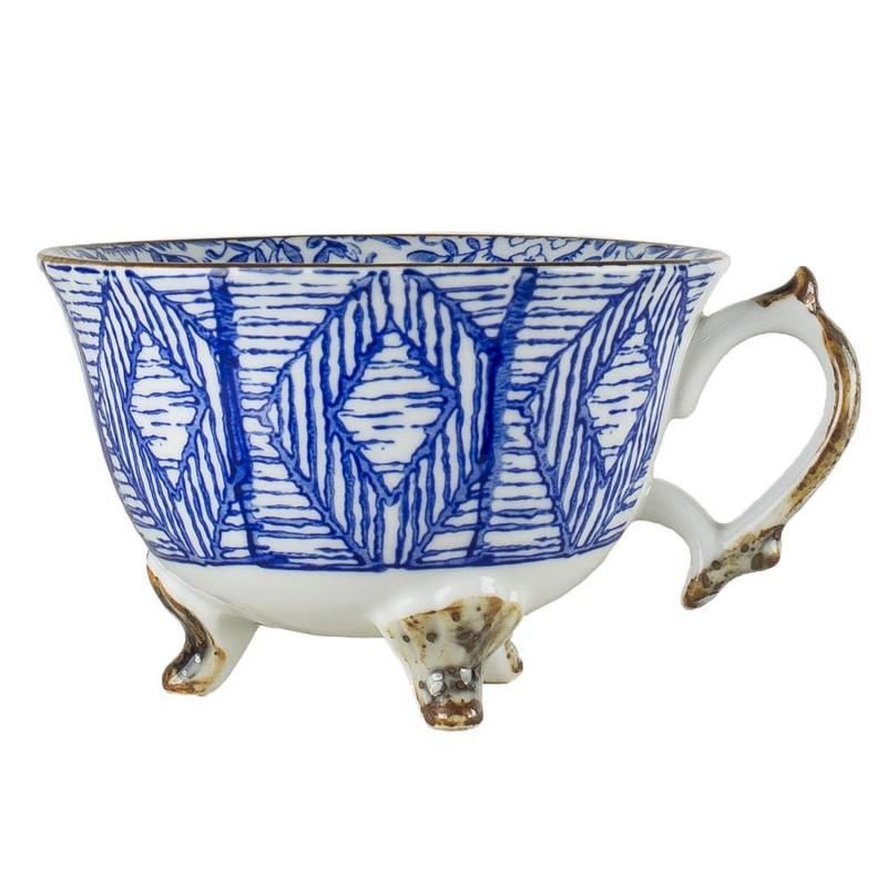 Kaffekopp Saga - kopp med fötter i guldbrun ton