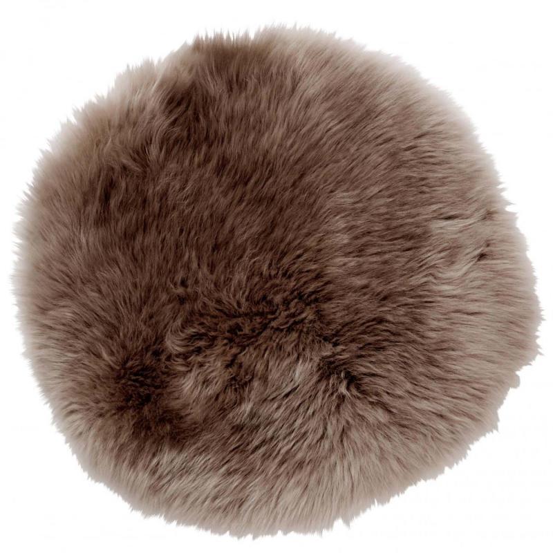 brun sittdyna i fårskinn