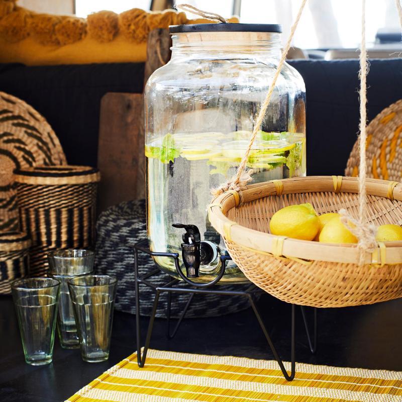 Glasbehållare med tappkran och ställning