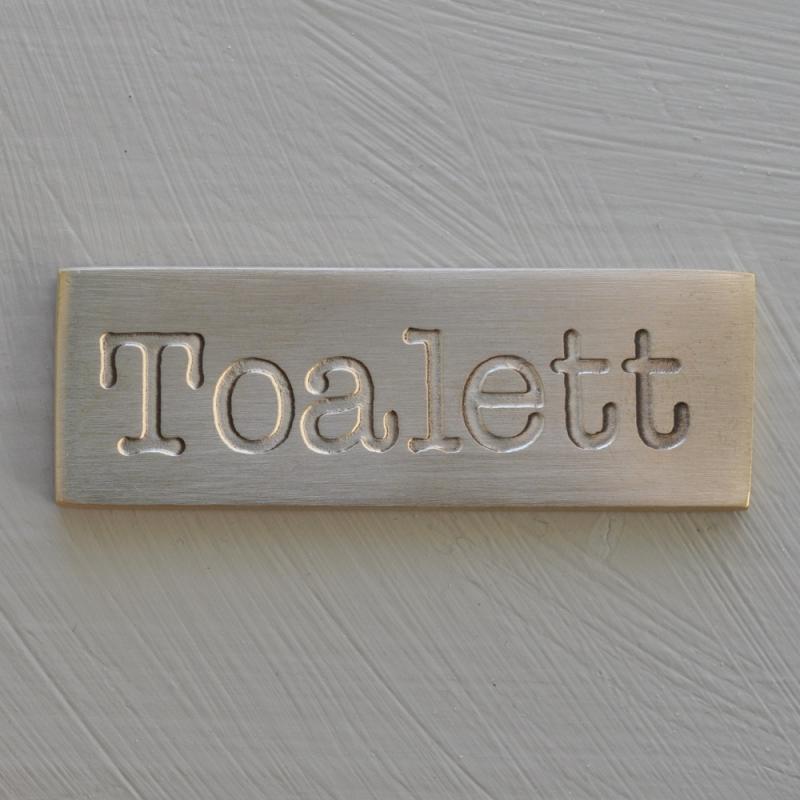 toalett - skylt i borstad mässing