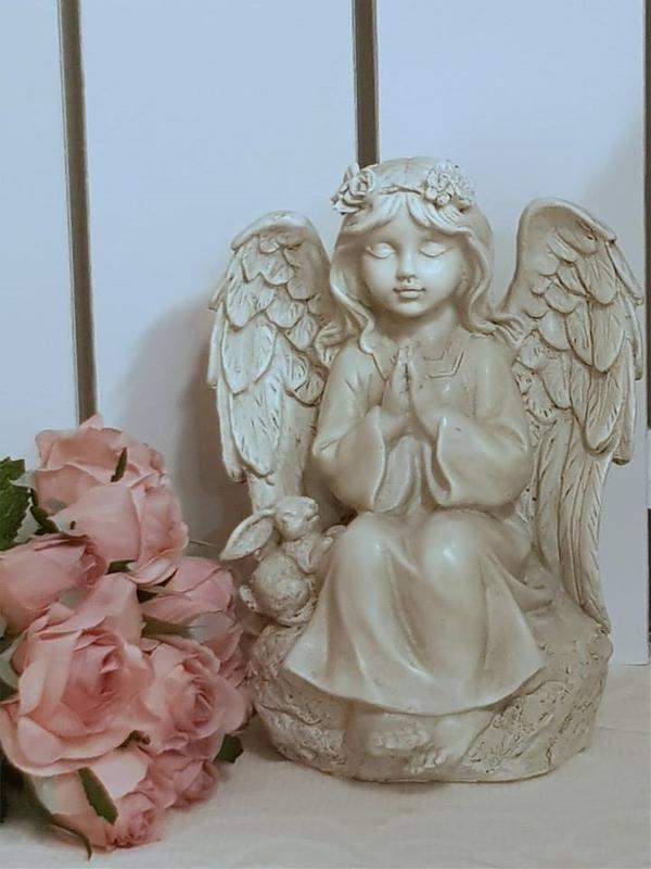 Bedjande Eden Ängel