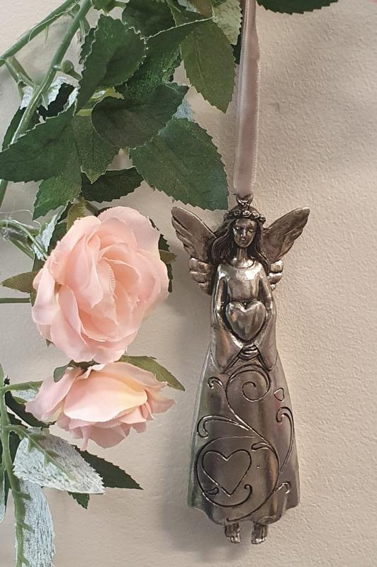 Hängande Ängel Håller Hjärta