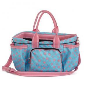 ljusblå ryktväska med rosa prickar