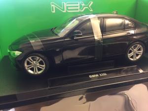 2010 BMW 335i *Premium Collection*, black 1/18