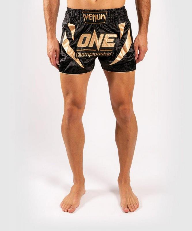 VENUM: X ONE MUAY THAI SHORTS - SVART/GULD