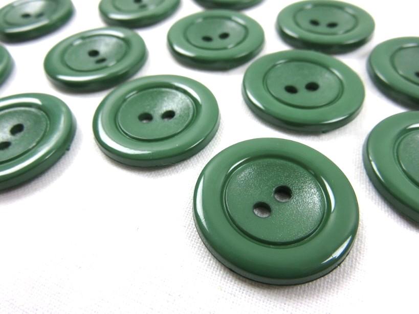 K002 Knapp 25 mm mörkgrön