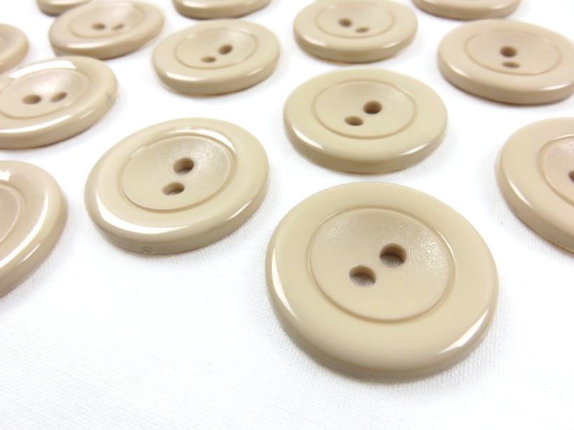 K002 Knapp 30 mm beige