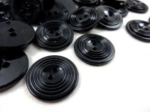 K017 Knapp 23 mm svart