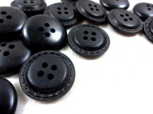 K019 Knapp 23 mm svart