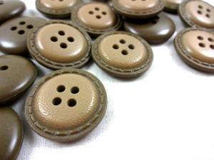 K019 Knapp 23 mm ljusbrun