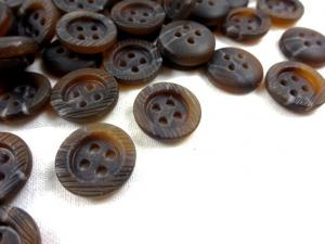 K103 Knapp 15 mm melerad brun