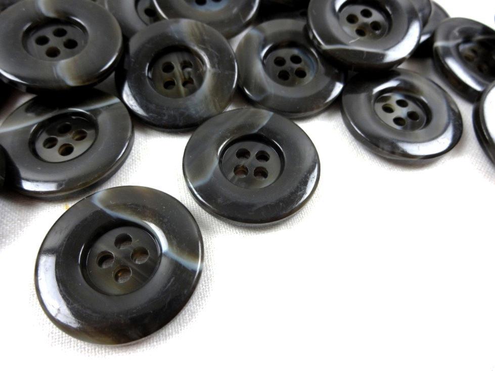 K299 Knapp 25 mm melerad mörkbrun