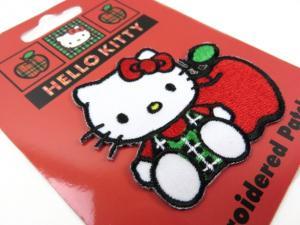 M255 Tygmärke Hello Kitty äpple