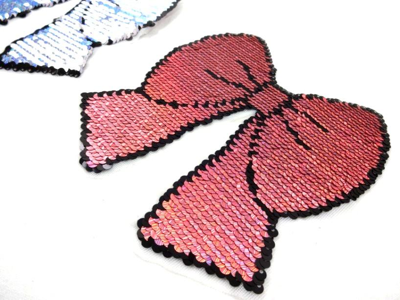 M320 Vändbart paljettmärke rosett rosa