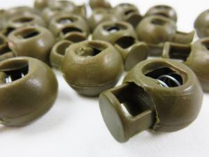 Snörlås boll 18 mm guldbrun