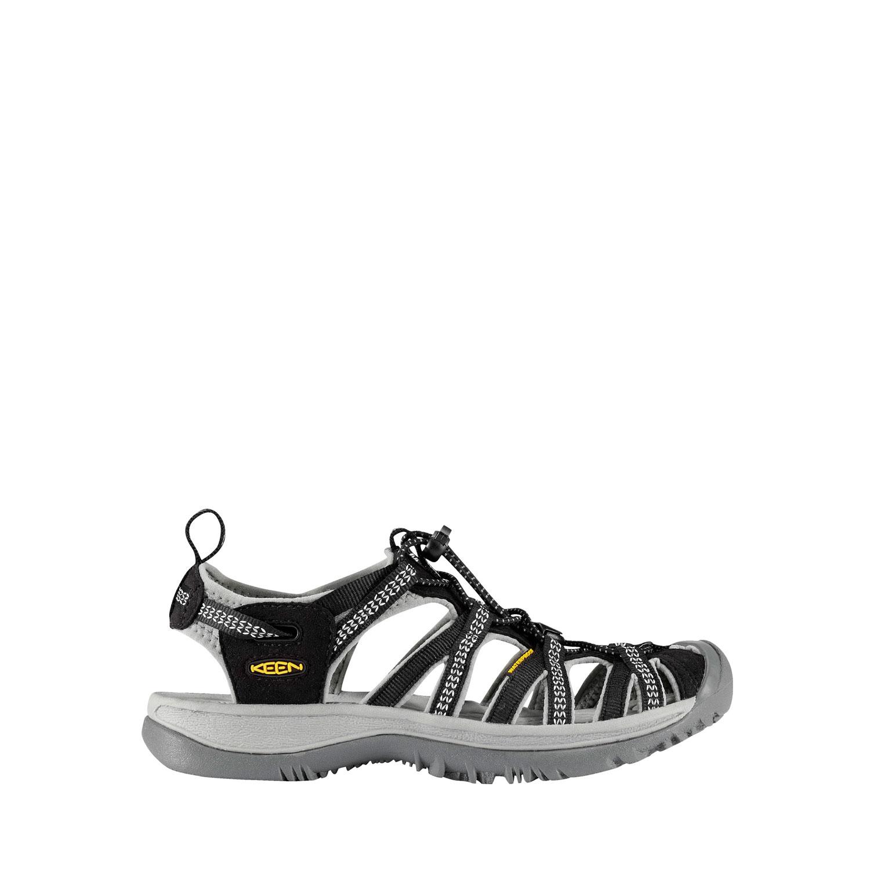 Svart sandal med tåskydd sedd från sidan