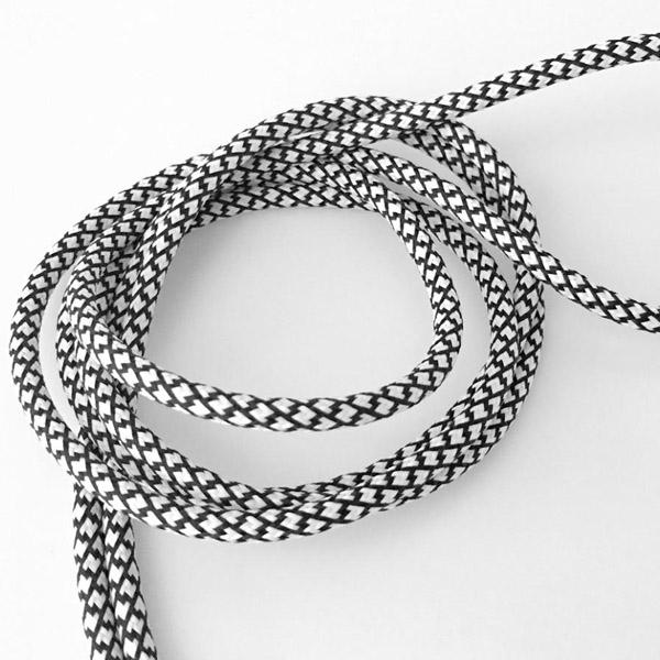 Sidospår svart/vit textilkabel. Kabeln är ojordad och finns i flera olika längder.