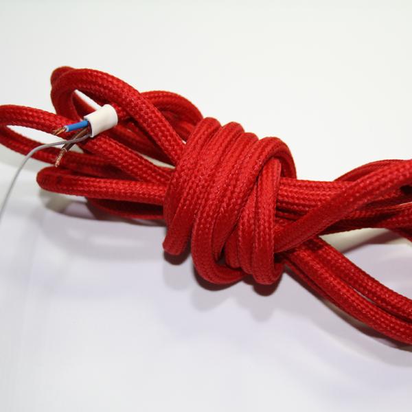 Röd textilkabel med vajer. Kommer i 3 meters bitar. Utan jordkabel.