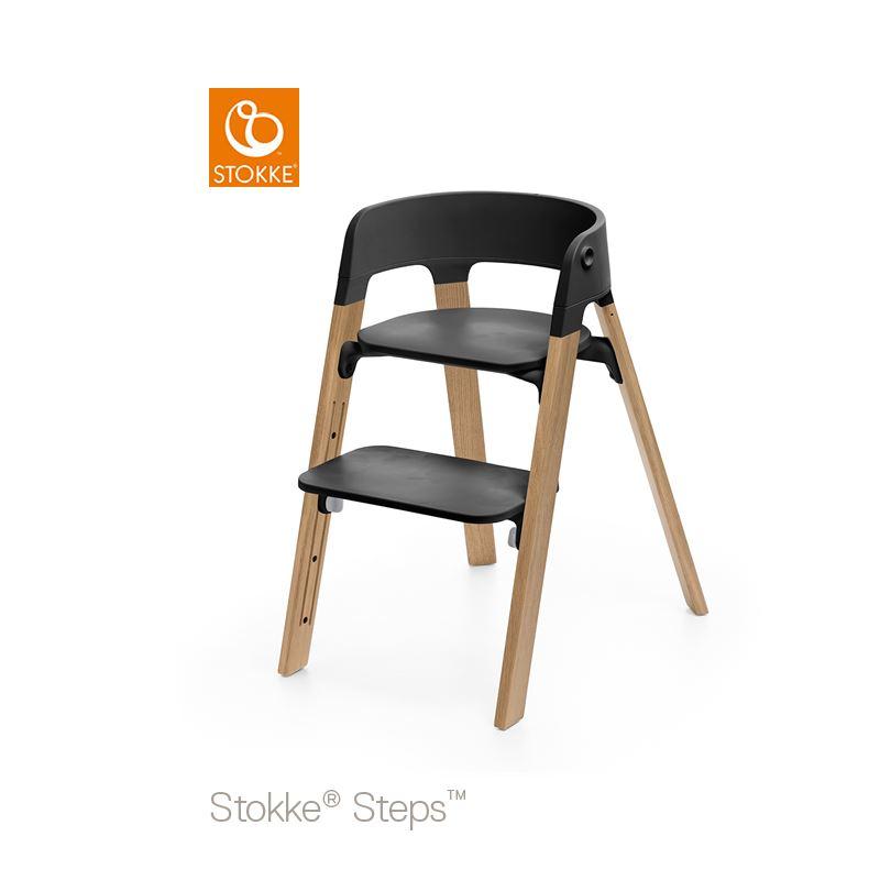 Stokke Steps Stol med Svart Sittdel och Stolsben i Ek Natural