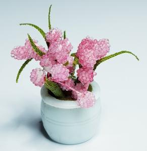 Blomma i kruka - ljusrosa