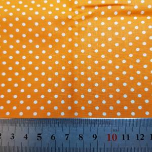 Tyg - orange vita prickar