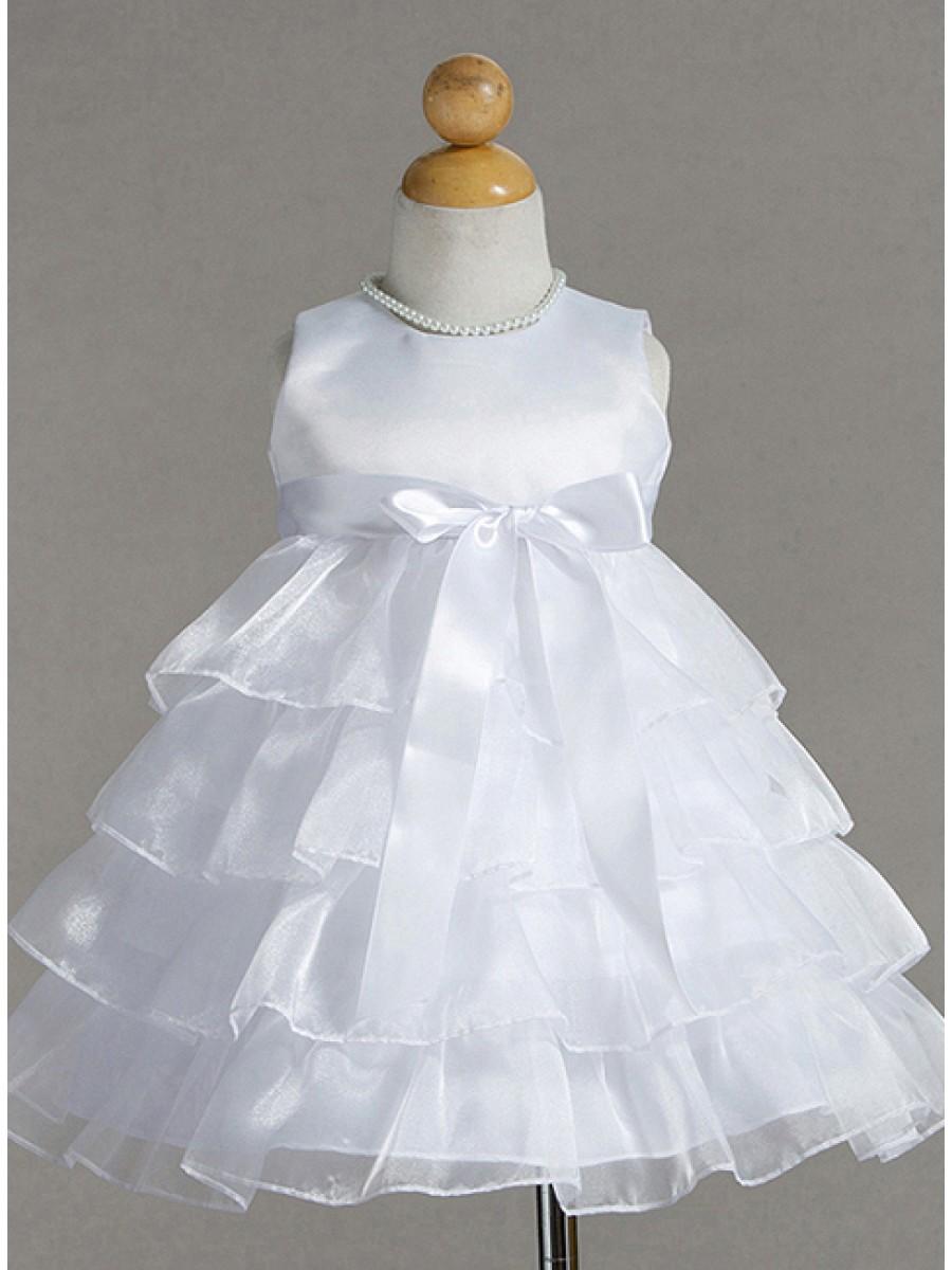 Kritvit babyklänning med volanger. Handla festkläder för barn hos oss! 100df94d745dd