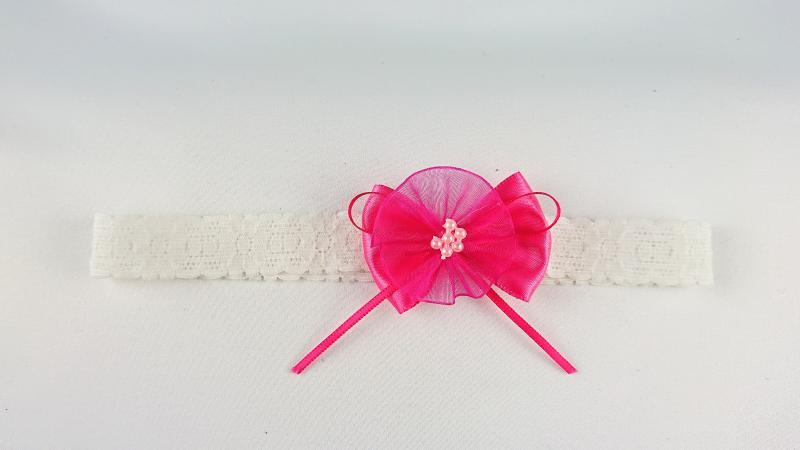 Hårband med rosett och blomma