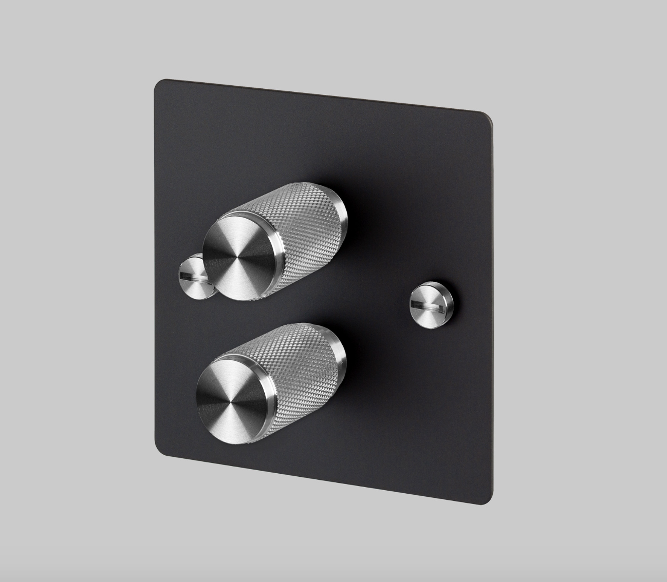 Buster & Punch svart platta med dubbel vridströmbrytare i stål