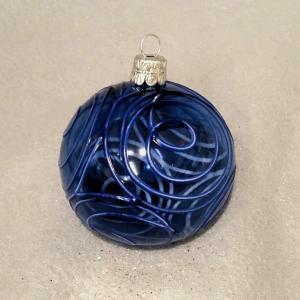 Blå transparent med utanpåliggande dekor i form av ringar