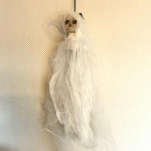 Spöke svart hängande med lysande huvud
