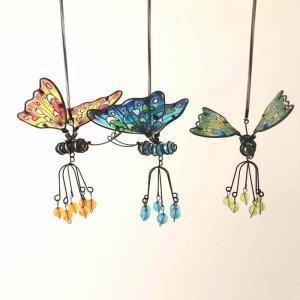 Fjäril hängande färgglad