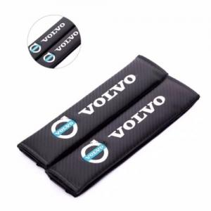 Volvo bälteskuddar i svart kolfiber, kuddar / kudde