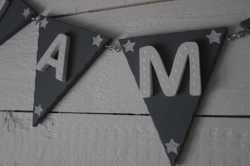 Vimpel med bokstav och stjärna