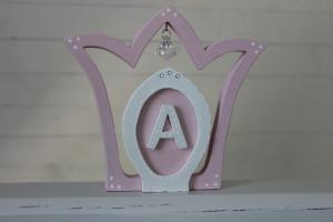 Krona med prisma och bokstav