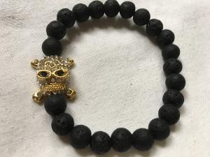 Lava armband/skull guld