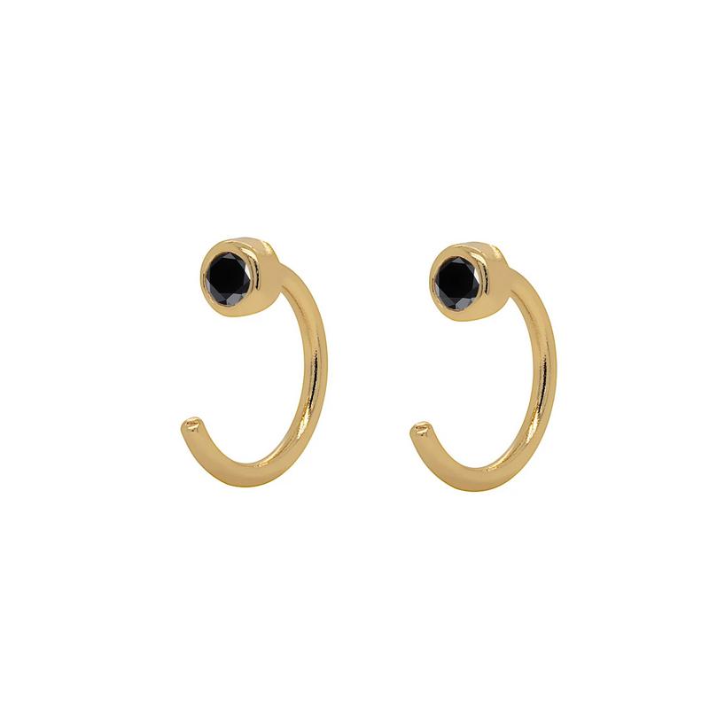Huggie Hoops-Örhängen - Tunna guldringar med svarta kristaller