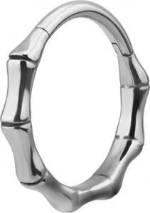 Ring i kirurgiskt stål som öppnas och stängs med gångjärn