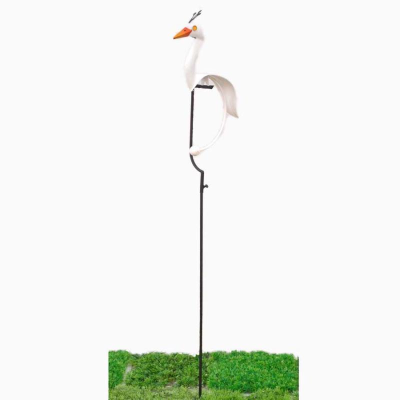 Gungande fågel på pinne