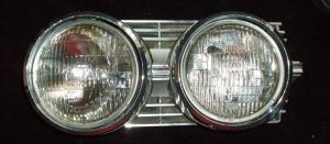 1964 Oldsmobile Jetstar lamppotta vänster (skadad i krom och hållare, nedre högra hörnet)