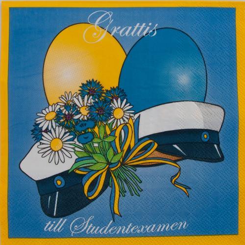 Servetter med ballonger, studentmössor och bommor. Blå huvudfärg