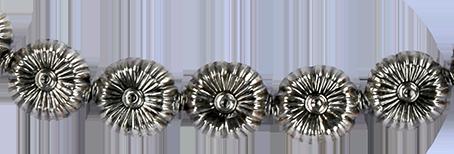 Blomma pärla av sterlingsilver. Hål från sida till sida. Priset är per styck.