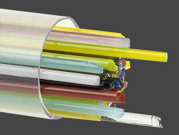 Stringers 2 mm färgmix. Ett rör med ca 50 st 45 cm långa glasstavar transparent