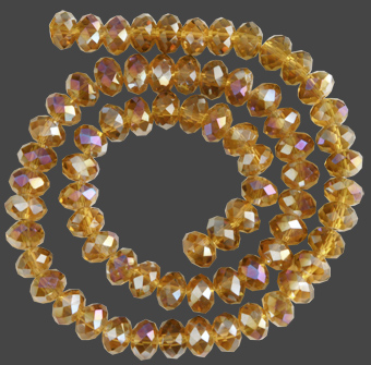 Glaspärlor facetterad rondell 6,5x4,5 mm. Amber