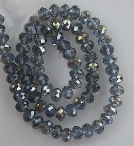 Glaspärlor facetterad rondell 6,5x4,5 mm. Grå med lite blå ton.