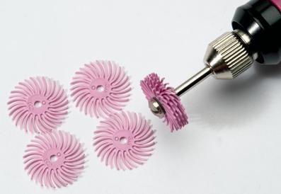 Polertrissa 4 st rosa, finkornig. (600 grit,12 micron) Skall sitta minst 4 trissor på en mandrel.