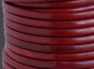Läderrem 5mm rund antik röd. Säljs per 20 cm.