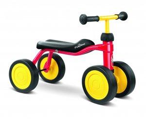 Röd balanscykel med fyra hjul