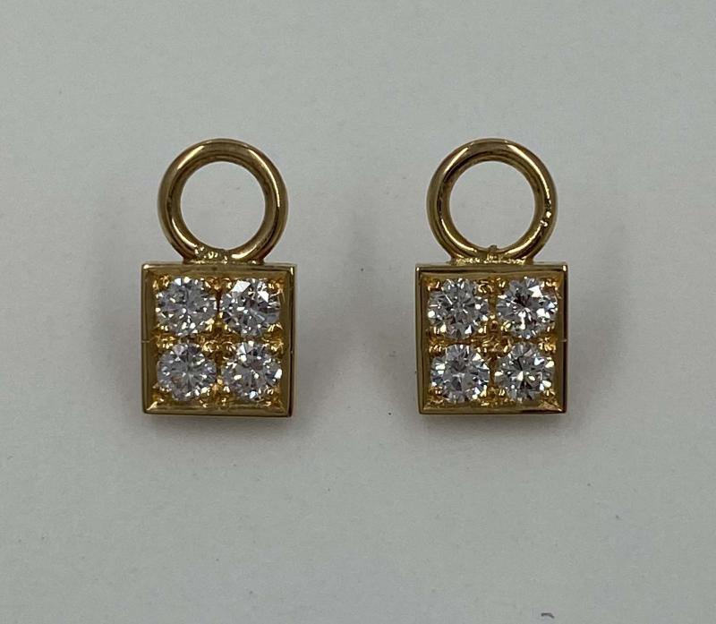 Plattor i rött guld med Diamanter.